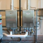 Do businesses save money with tankless water heaters